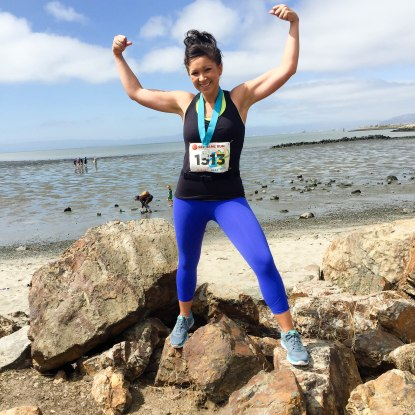 Flexing and feeling great after running and finishing the See Jane Run Half Marathon San Francisco race in Alameda