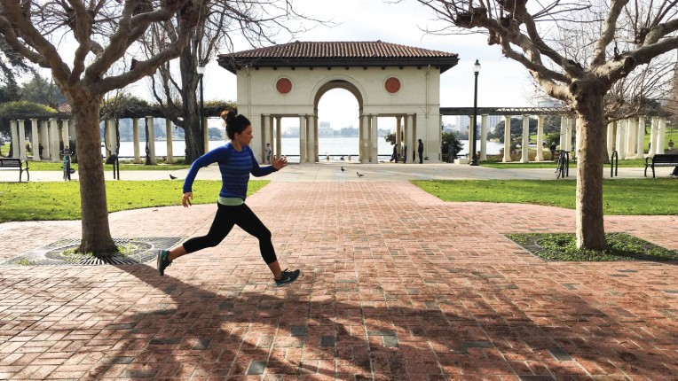 Melissa from Cook Slow Run Fast running by Lake Merritt in Oakland, CA.